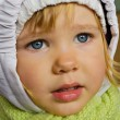 Beautiful little girl in winter clothes — Stock Photo
