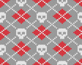 Knitted pattern with skulls — Stok Vektör