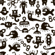 Black and white seamless pattern with funny monsters. — Stock Vector #47711629