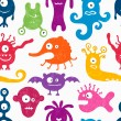 Seamless pattern with funny monsters. — Stock Vector #47711685