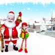 Santa claus with reindeer and gifts on iceland - Stock Photo
