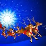 Santa claus with his sleigh — Stock Photo #13700280