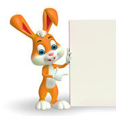 Cute Easter Bunny with card — Stock Photo