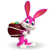 Easter bunny carries eggs basket — Stok fotoğraf