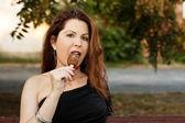 Beautiful woman is eating ice cream — Stock Photo