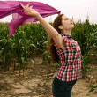 Beautiful women with silk scarf in a maize field — Stock Photo