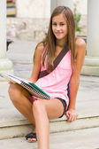 Tanned young student girl. — Stock Photo
