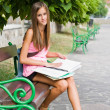 Stock Photo: Beautiful young student girl studying outdoors.