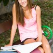 Beautiful young student girl studying outdoors. - Stockfoto