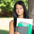 Attractive young brunette student outdoors. — Stock Photo #12508483