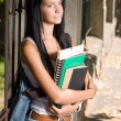 Attractive young brunette student outdoors. — Stock Photo