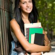 Royalty-Free Stock Photo: Attractive young brunette student outdoors.