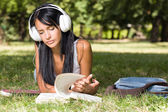 Gorgeous young relaxed student in the park. — Stock Photo