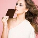 Chocolate loving beauty. — Stock Photo #12865191