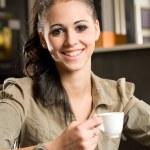 Fashionable young brunette woman having coffee. — Stok fotoğraf