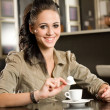 Beautiful young brunette and her coffee. — Stock Photo #13421222