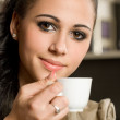 Beautiful young brunette and her coffee. — Stok fotoğraf