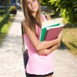 Stock Photo: Beautiful friendly teen student girl.