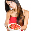 Young beauty offering strawberries. — Stock Photo #13624761