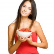 Brunette beauty with a bowl of strawberries. — Stock Photo