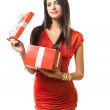 Brunette beauty with bright red gift box. — Stock Photo