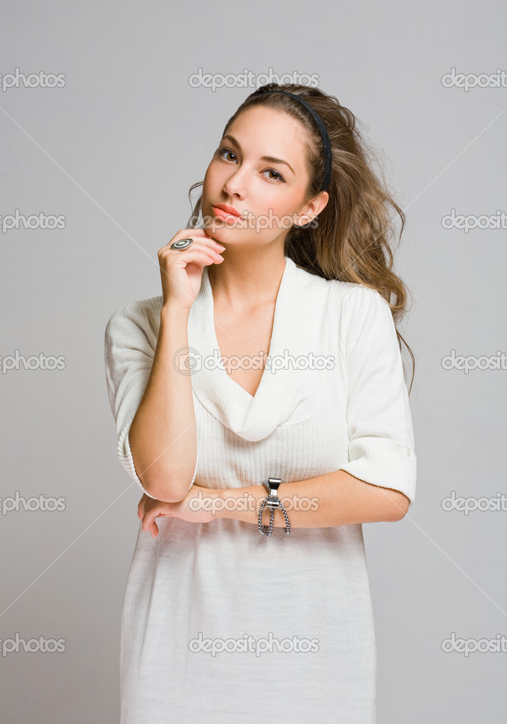 Studio portrait of freindly pensive young brunette beauty. — Stock Photo #18186243