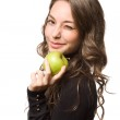 Fit young brunette with green apple. — Stock Photo #18394041
