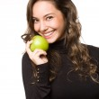 Fit young brunett with apple. — Stock Photo #18694653