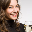 Brunette beauty with white wine. — Stock Photo #19037815