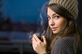 Gorgeous young brunette holding tea. — Stock Photo