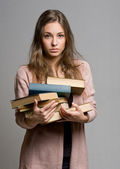 Stressed looking young student woman. — Stock Photo