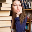 Exhausted young brunette student. - Stock Photo