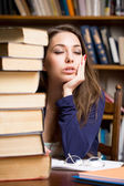 Exhausted young brunette student. — Stock fotografie