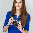 Teen girl with a photo camera. — Stock Photo #21017087
