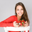 Happy young brunette with strawberies. — Stock Photo #21262881