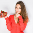 Cute thoughtful brunette with strawberries. — Stock Photo #21262913
