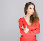 Brunette showing big thumbs up. — Stok fotoğraf
