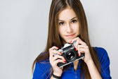 Teen cutie with vintage camera. — Stock Photo