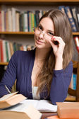 Busy young brunette student — Stock Photo
