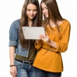 Teenagers having fun with a tablet computer. — Stock Photo