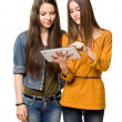 Royalty-Free Stock Photo: Teen girls sharing a tablet computer.