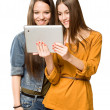 Teen girls sharing a tablet computer. — Stock Photo
