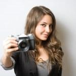 Brunette beauty holding vintage camera. — Stock Photo #24131239