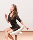 Festive champagne brunette. — Stock Photo