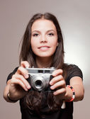 Brunette woman with vintage camera. — Stock Photo