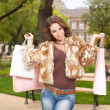 Gorgeous brunette goes shopping. — Stock Photo #32770475