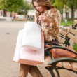 Young brunette shopping woman. — Stock Photo