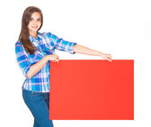 Cute brunette with blank sign. — Stock Photo