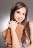 Beautiful brunette student. — Stock Photo