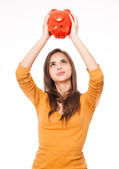 Brunette with piggy bank. — Stock Photo